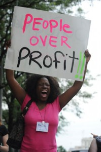 People Over Profit 2011 protest sign