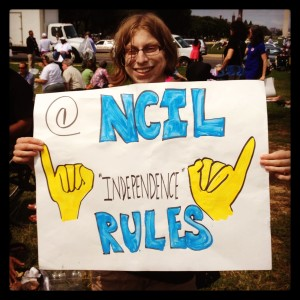 Protest sign - NCIL - Independence Rules! Sign features a drawing of the word independence in ASL
