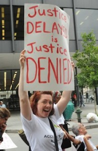 Justice Delayed Is Justice Denied sign at the 2012 Conference