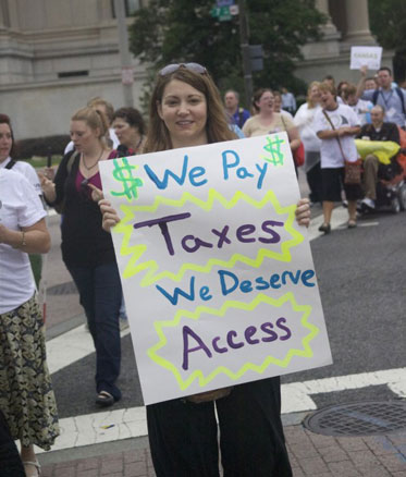 We pay taxes we deserve access - 2012 protest sign