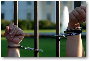 ADAPTers hands chained to White House Fence