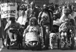 "Old school disability rights protest – signs read ""we shall overcome"" and ""access is a civil right"" – photo by Tom Olin"