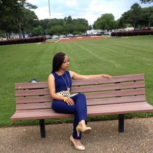 Keri Gray Sitting on a bench looking sharp