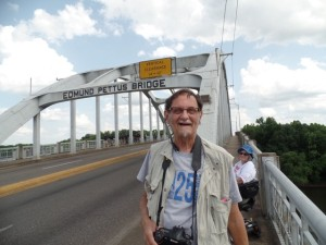 Image: Tom Olin stands on the Edmund Pettus Bridge.