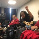 4 members of ADAPT pictured together - Anita Cameron has her fist raised in power
