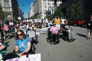 Hundreds of NCIL Members march through the streets of DC in 2017