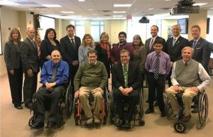 Sixteen people gather for a group photo at the Stakeholders' Forum on Accessible Parking and Disabled Placard Abuse, December 6, 2017 at U.S. Access Board offices