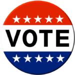 """A circular button that says """"VOTE"""" and has red and blue stripes with white stars"""